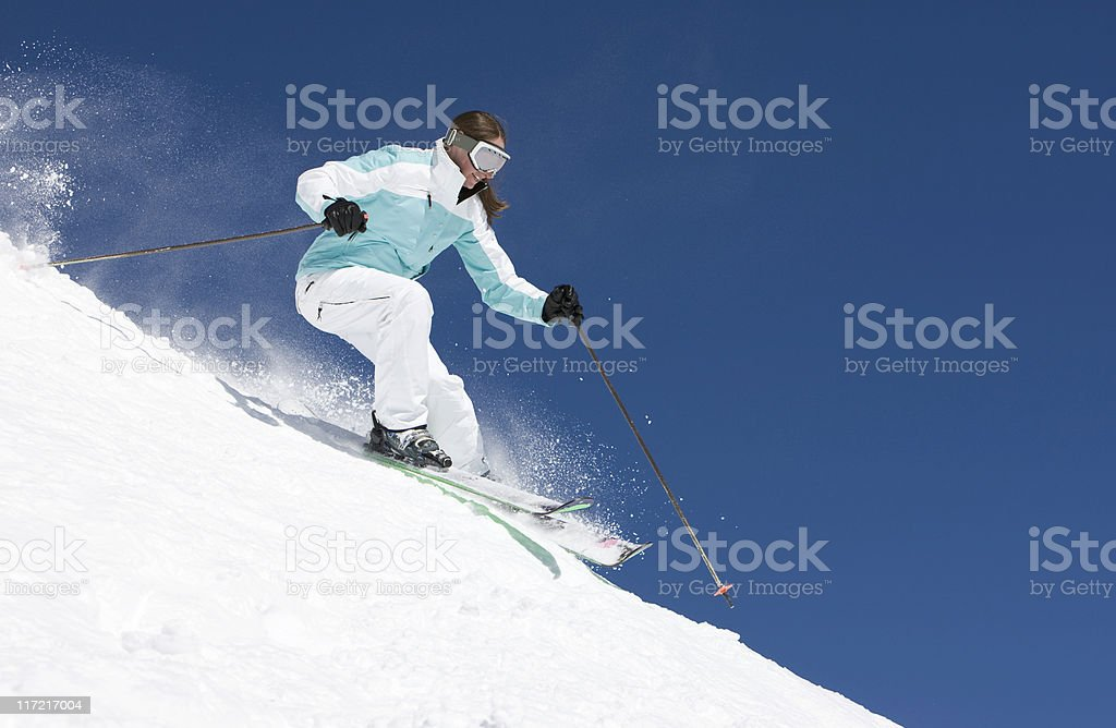Woman Snow Skiing Against Blue Sky royalty-free stock photo