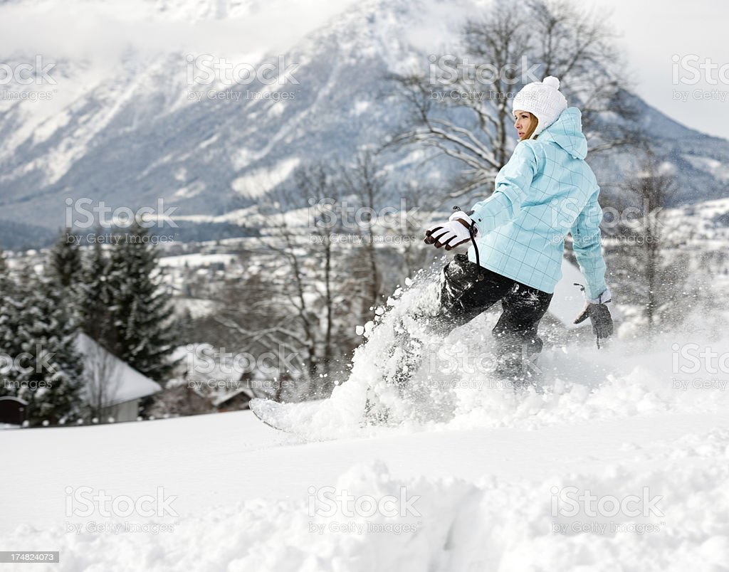 Woman Snowboarder in fresh Powder Snow, Alps Panorama royalty-free stock photo
