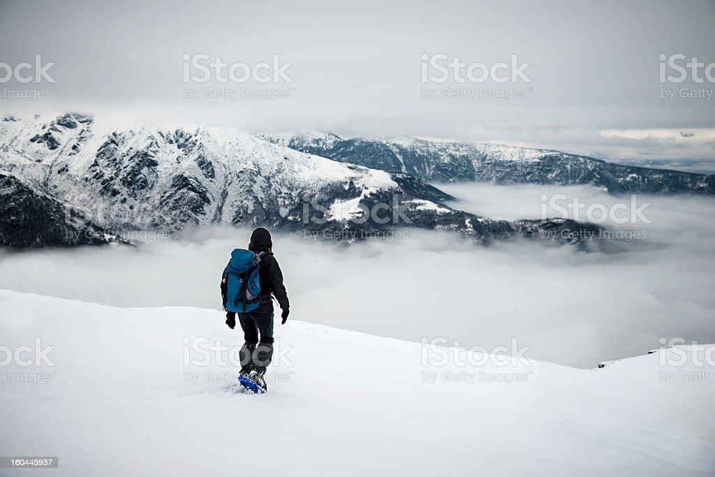 Woman Snowshoeing On Mountain Top royalty-free stock photo