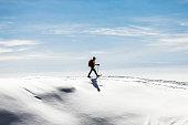 Woman snowshoeingon snow field