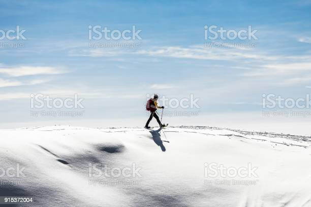 Woman snowshoeingon snow field picture id915372004?b=1&k=6&m=915372004&s=612x612&h=vnocpxuuq8zhd szy5lc30neyfi1fcpabc59tdktoxo=