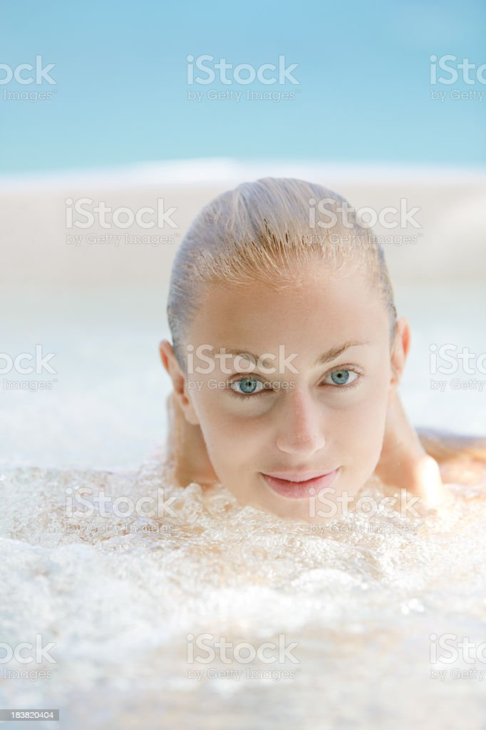 woman soaking in a jacuzzi whirlpool at the spa resort stock photo