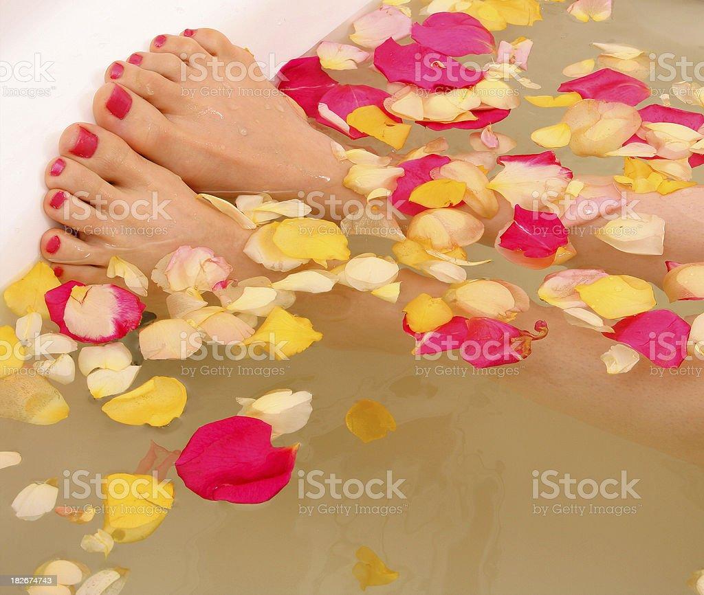 woman soaks feet royalty-free stock photo