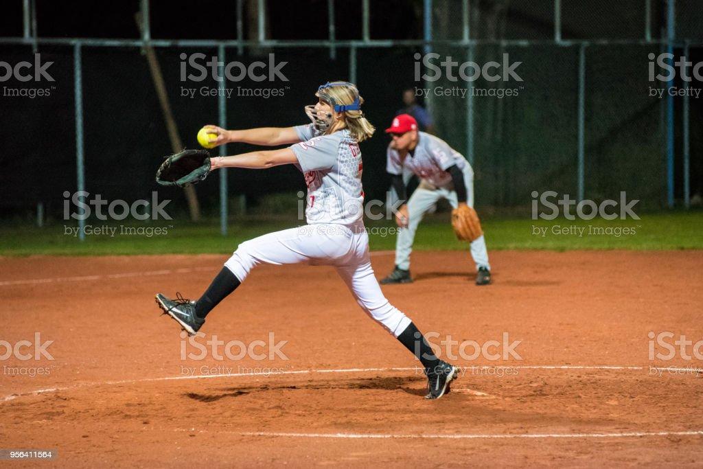 Woman Softball Pitcher Throwing the Ball.