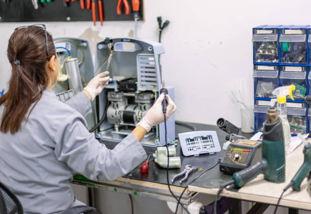 Woman soldering machine in workshop Woman soldering machine in workshop soldering iron stock pictures, royalty-free photos & images