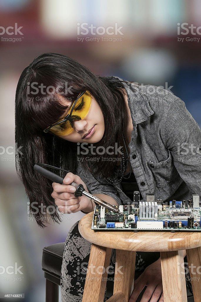 Woman soldering stock photo