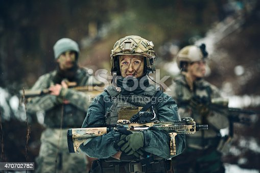 istock woman soldier member of ranger squad 470702782