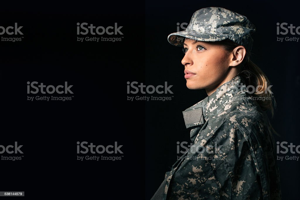 Woman soldier Portrait of beautiful woman soldier isolated on black background 20-29 Years Stock Photo