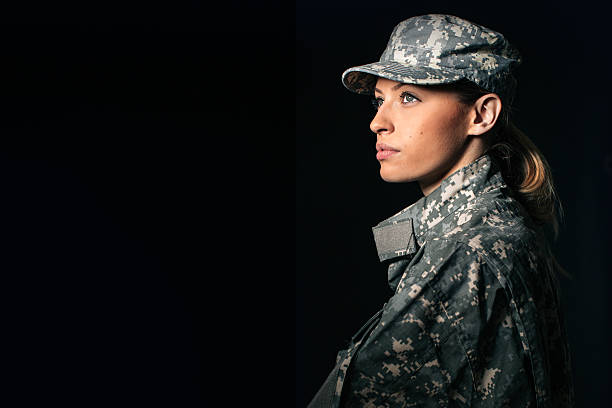 Woman soldier Portrait of beautiful woman soldier isolated on black background air force stock pictures, royalty-free photos & images