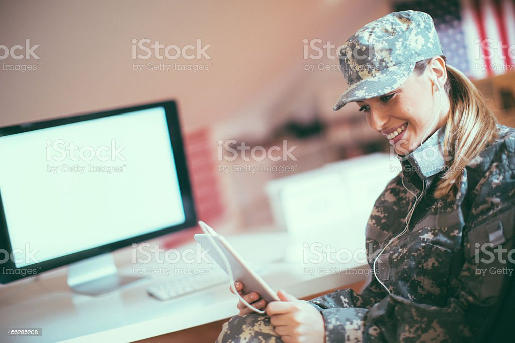 Woman soldier talking with her family stock photo