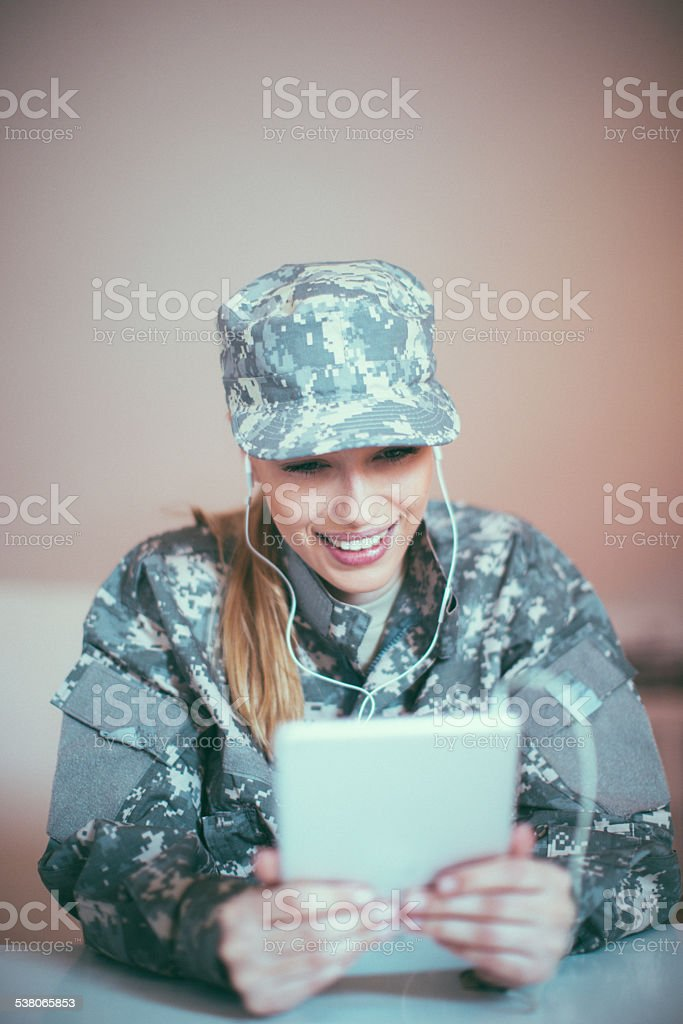Woman soldier using tablet stock photo
