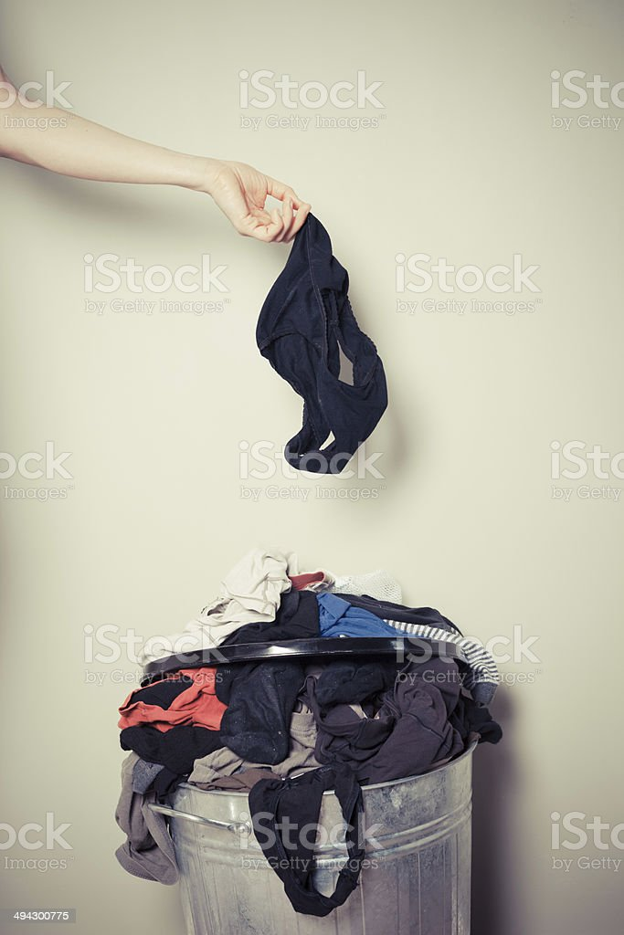 Woman sorting out her laundry stock photo