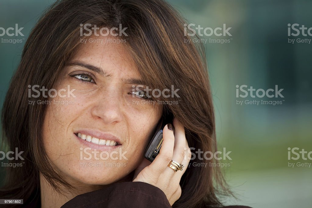 Woman speaking at the cellphone royalty-free stock photo