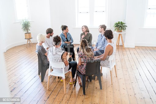 istock Woman speaking in group therapy session 923258836