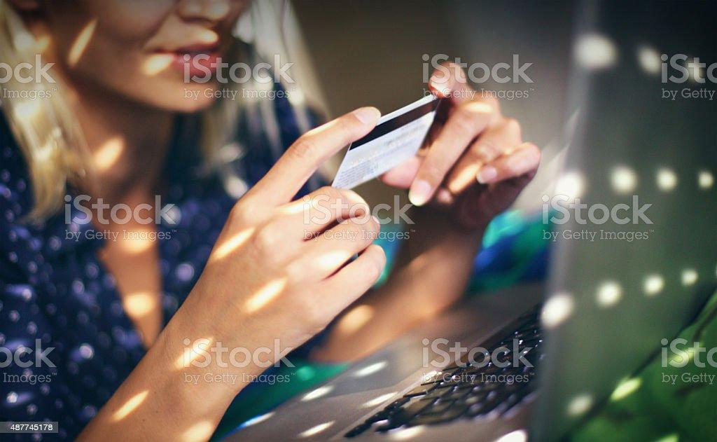 Woman spending money online. stock photo