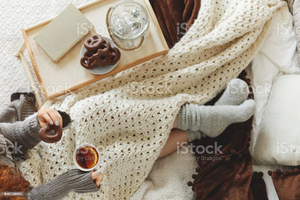 Woman spending night in bed stock photo