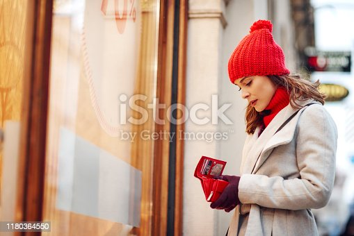 istock Woman spent all her money during Christmas shopping 1180364550