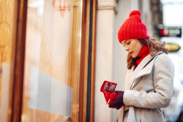 Woman spent all her money during Christmas shopping Woman spent all her money during Christmas shopping wallet money stock pictures, royalty-free photos & images