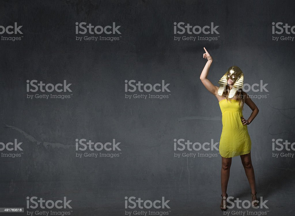 woman sphinx indicated with finger up stock photo