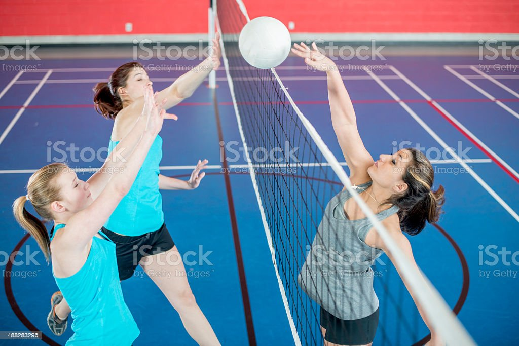 Woman Spiking Ball Over the Net stock photo