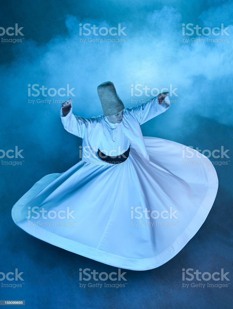 Woman spinning as her white dress floats outwards stock photo