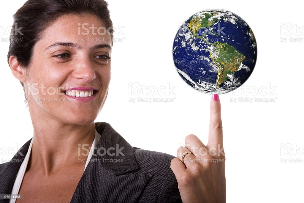 Woman spins the earth on pointer finger royalty-free stock photo