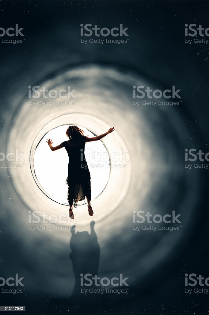Woman Spirit Floating Into The Light stock photo
