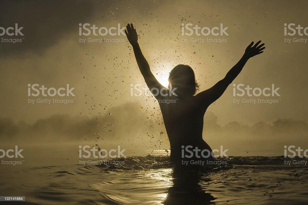 Woman splashing in water royalty-free stock photo