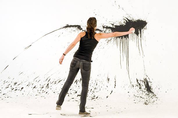 woman splashing the wall stock photo