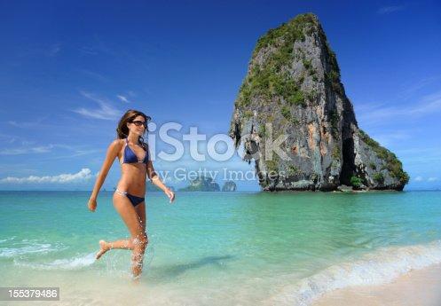 istock Woman splashing through the water at Railay Beach, Thailand (XXXL) 155379486