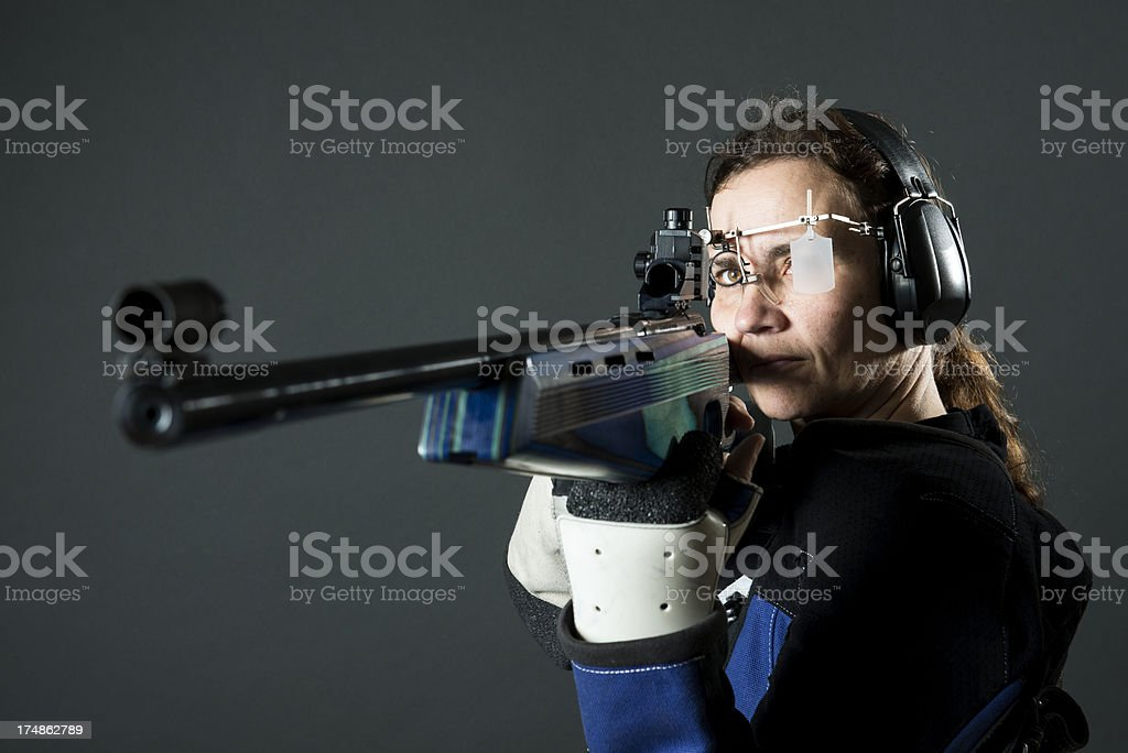 Woman sport shooter with a .22 rifle royalty-free stock photo