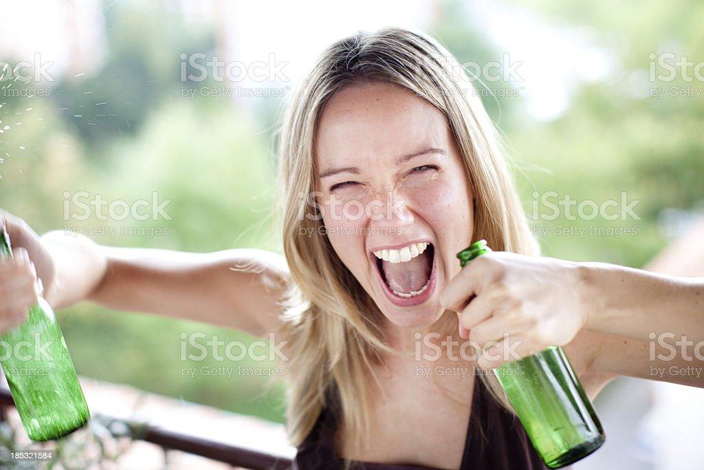 Woman spraying beer royalty-free stock photo