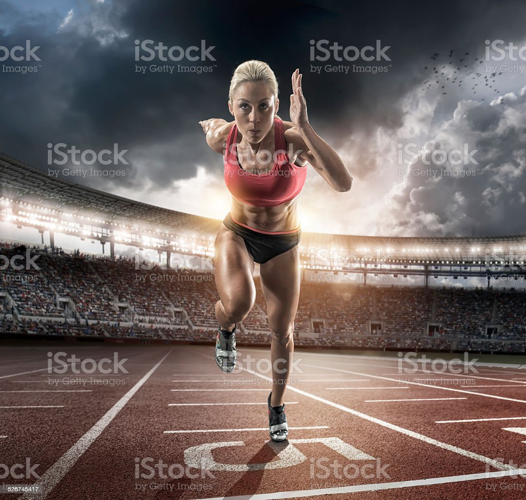 woman sprinting stock photo
