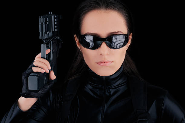 Woman Spy Holding Gun stock photo