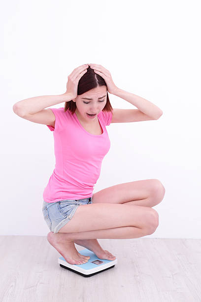 Crouching Asian woman stock photo. Image of alone, person