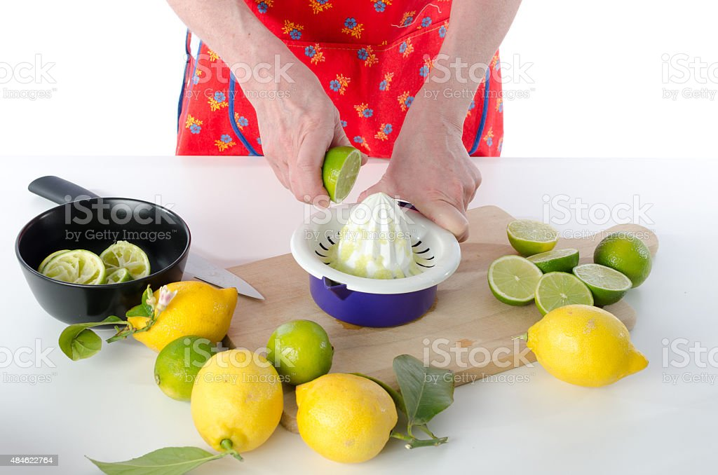 Woman squeezing half a lime stock photo
