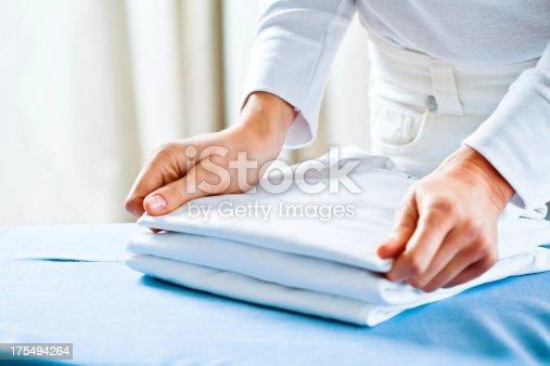 istock Woman Stacking Ironed Folded Shirts 175494264
