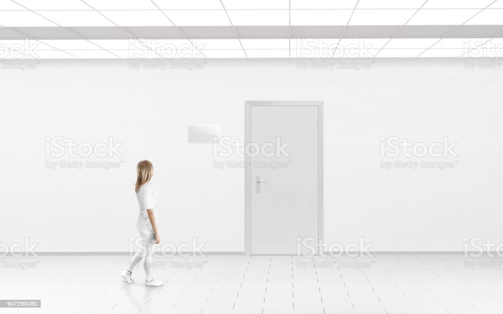 Woman Stand Near Door With Blank Glass Name Plate Mockup Stock Photo
