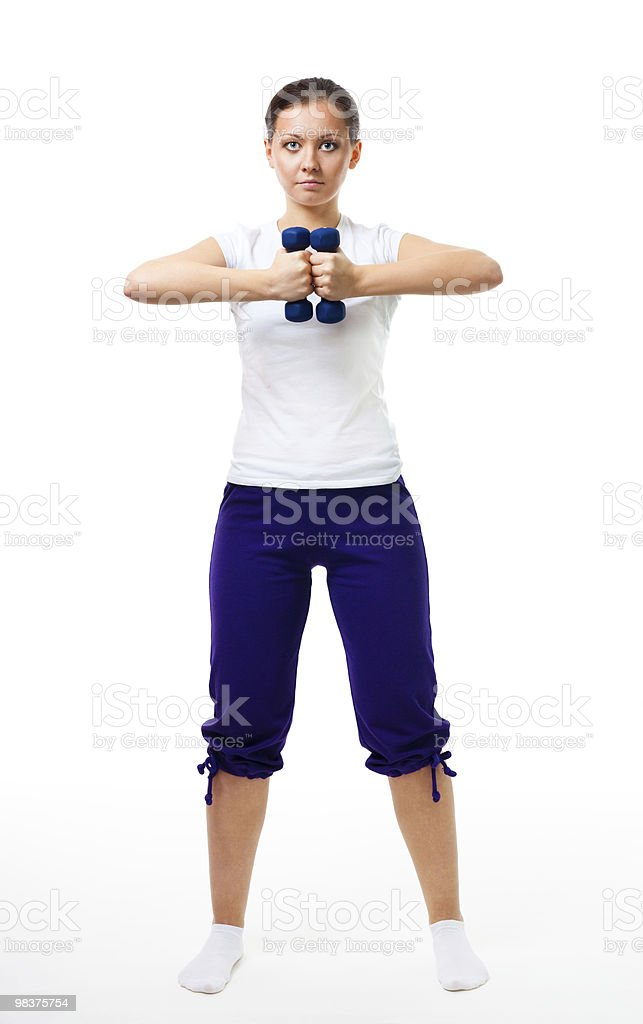Woman stand with dumbbells royalty-free stock photo