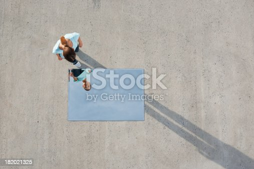 istock Woman standing above mirror and reflection outdoors 182021325