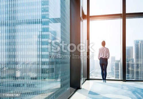 Woman standing and looking at cityscape