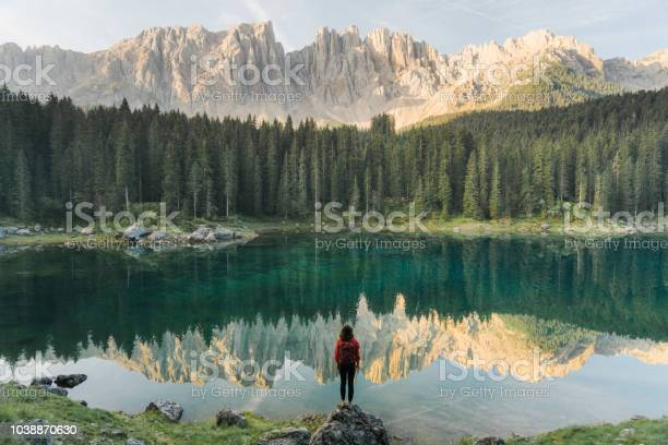 Woman standing and looking at lago di carezza in dolomites picture id1038870630?b=1&k=6&m=1038870630&s=612x612&h=vg8wqwurm59vm9wtwaqnmj5tp6b7xadew6sx6mhzgli=