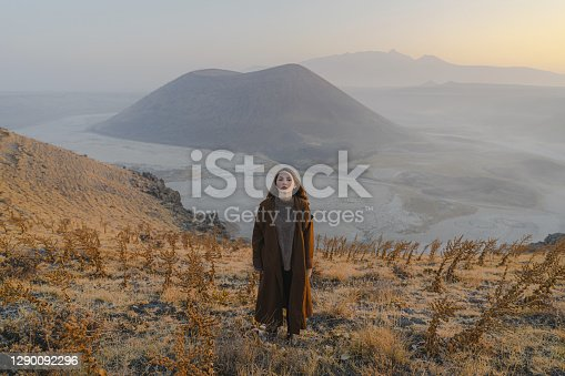 Young Caucasian woman looking at scenic view of volcano