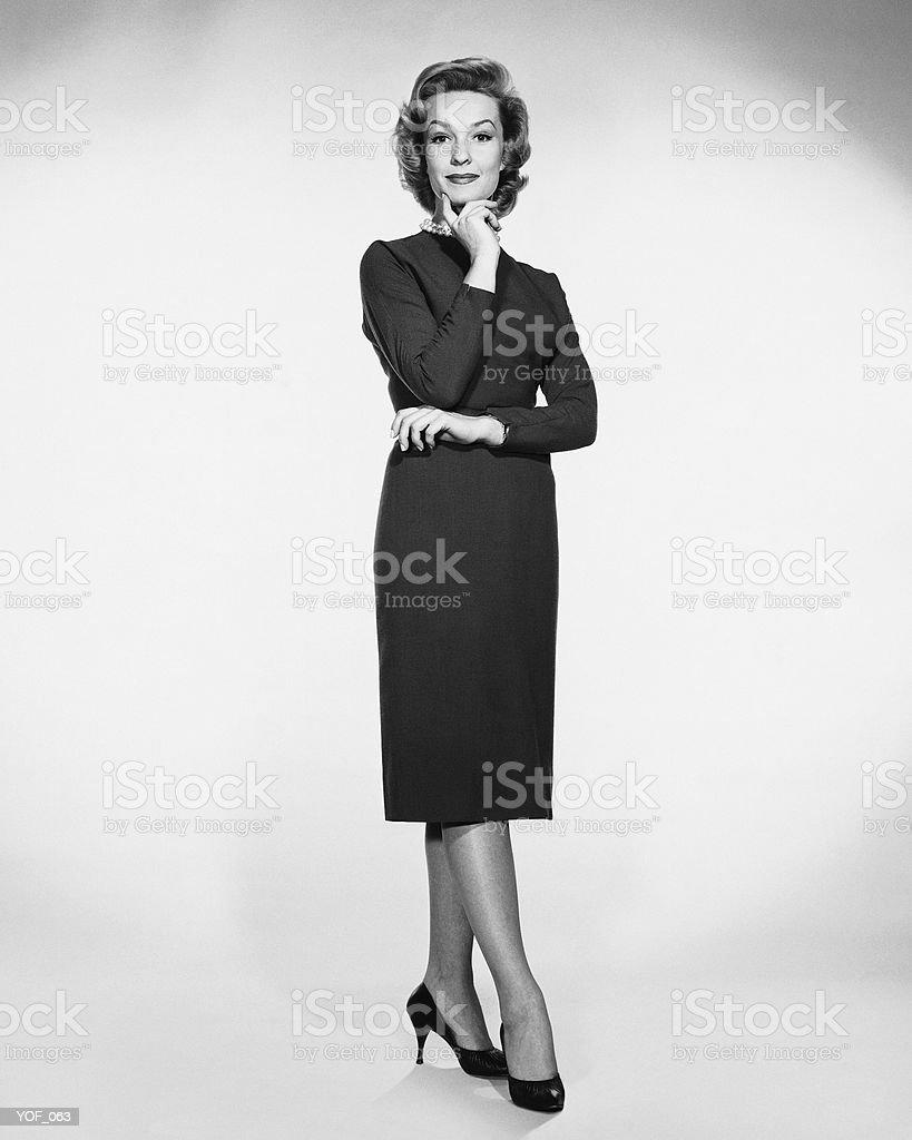 Woman standing and posing royalty free stockfoto