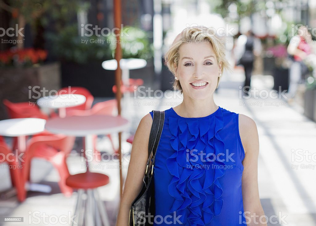 Woman standing at outdoor cafe royalty-free stock photo