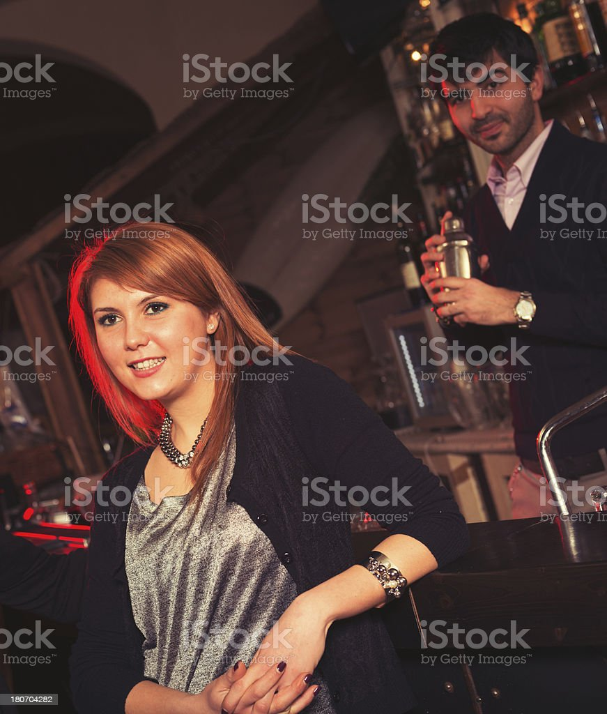 woman standing at the bar counter royalty-free stock photo