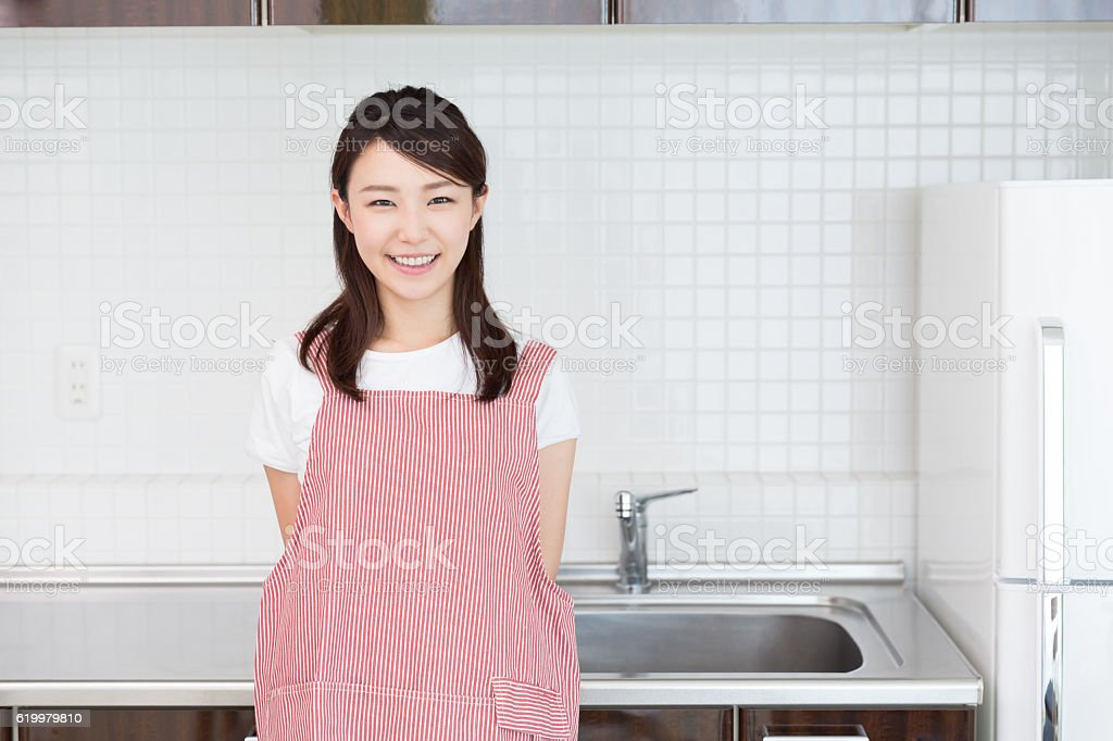 Woman standing in a kitchen stock photo
