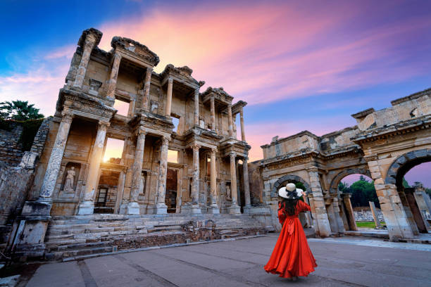 Woman standing in Celsus Library at Ephesus ancient city in Izmir, Turkey. stock photo