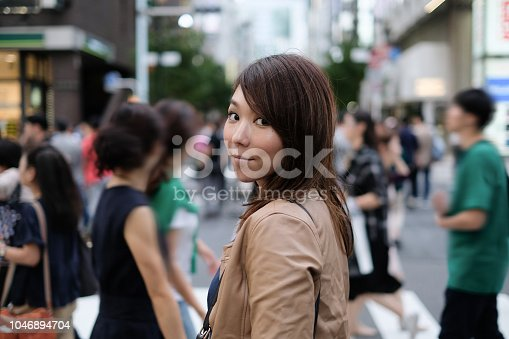 Woman walking in Ginza, Tokyo, one of the most famous commercial district in Japan