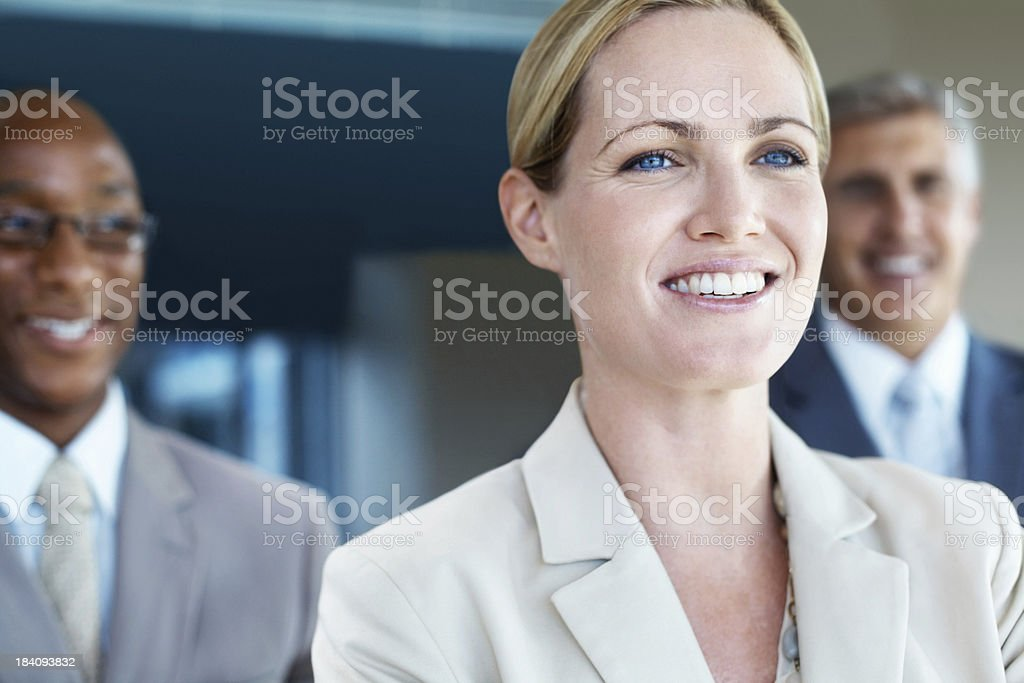 Woman standing in front of her team royalty-free stock photo